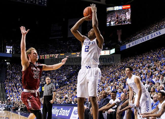 Kentucky guard Aaron Harrison shoots a three point shot during the second half of the University of Kentucky Men's Basketball game versus University of South Carolina basketball game at Rupp Arena in Lexington , Fl., on Saturday, February 14, 2015. . Photo by Jonathan Krueger | Staff