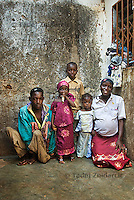 Sani Abdullahi, 24 with his wife and their three children in the courtyard of their home. His wife and the children are not polio victims.
