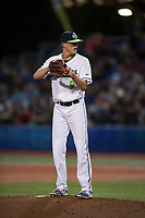 Hillsboro Hops relief pitcher Justin Garcia (9) gets ready to deliver a pitch during a Northwest League game against the Salem-Keizer Volcanoes at Ron Tonkin Field on September 1, 2018 in Hillsboro, Oregon. The Salem-Keizer Volcanoes defeated the Hillsboro Hops by a score of 3-1. (Zachary Lucy/Four Seam Images)