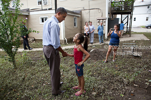 United States President Barack Obama greets a girl while touring a neighborhood affected by Hurricane Irene in Wayne, New Jersey, September 4, 2011. .Mandatory Credit: Pete Souza - White House via CNP
