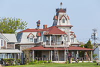Workers make spring roof repairs to a Victorian era home on Ocean Avenue in Oak Bluffs, Massachusetts on Martha's Vineyard.