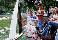 A family play together with their remote controled sail boat in Parque Lincoln, Polanco, Mexico City, September, 2005