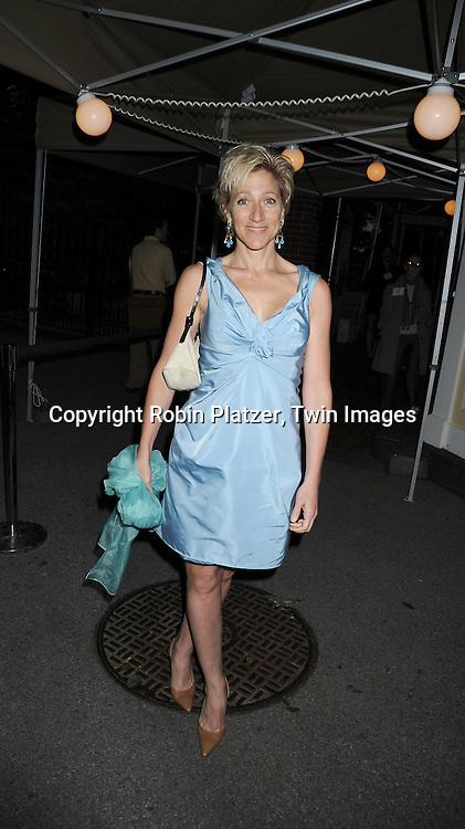 Edie Falco in light blue Marc Jacobs dress