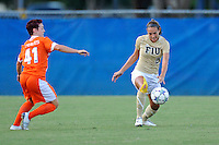 21 August 2011:  FIU's Chelsea Leiva (2) receives a pass despite the efforts of Florida's Taylor Travis (41) for the ball in the first half as the University of Florida Gators defeated the FIU Golden Panthers, 2-0, at University Park Stadium in Miami, Florida.