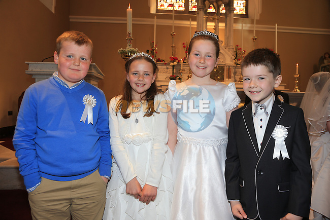 Alex McAleer, Sarah Rochford, Eimear Hughes and Rory Houlihan.at First Comunion in Termonfeckin church..Picture:  www.newsfile.ie ..