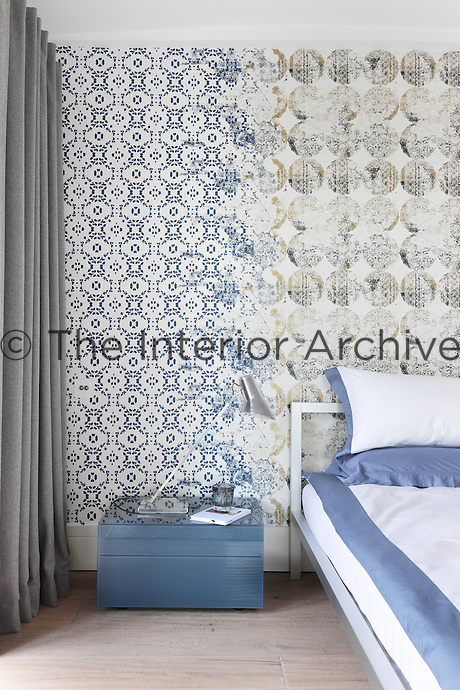 An unusual wallpaper with a pattern like overlapping stencilling has been used for one of the bedroom walls