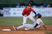 Dylan Moore (6) of the Hickory Crawdads steals second base ahead of the tag by Daniel Mendick (22) of the Kannapolis Intimidators at Kannapolis Intimidators Stadium on April 7, 2016 in Kannapolis, North Carolina.  The Crawdads defeated the Intimidators 5-1.  (Brian Westerholt/Four Seam Images)