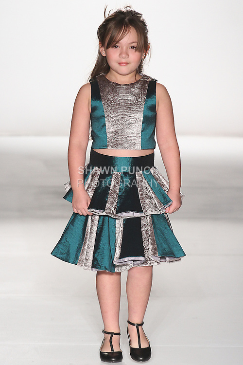 "Child model walks runway in an outfit from the Ericka Castaneda Fall Winter 2015 ""Notre Madame"" collection, during the Emerging Designers Fall Winter 2015 fashion show for  Fashion Gallery New York Fashion Week Fall 2015."