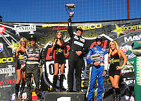 Apr 16, 2011; Surprise, AZ USA; LOORRS driver Jacob Person (center), C.J. Greaves (left) and R.J. Anderson on the podium following round 3 at Speedworld Off Road Park. Mandatory Credit: Mark J. Rebilas-.