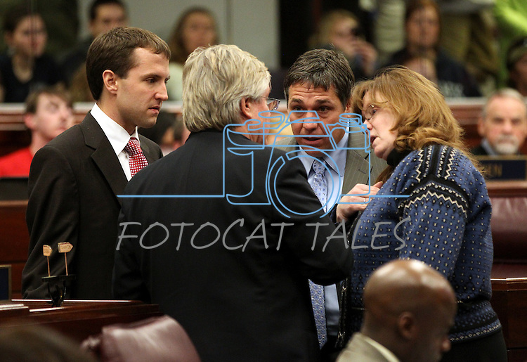 Nevada Assembly Democrats, from left, Elliot Anderson, Tick Segerblom, Marcus Conklin and Maggie Carlton talk on the Assembly floor at the Legislature in Carson City, Nev., on Monday, March 21, 2011. Photo by Cathleen Allison