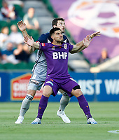 1st February 2020; HBF Park, Perth, Western Australia, Australia; A League Football, Perth Glory versus Melbourne Victory; Bruno Fornaroli of Perth Glory and James Donachie of Melbourne Victory compete for position as the goal kick comes in high