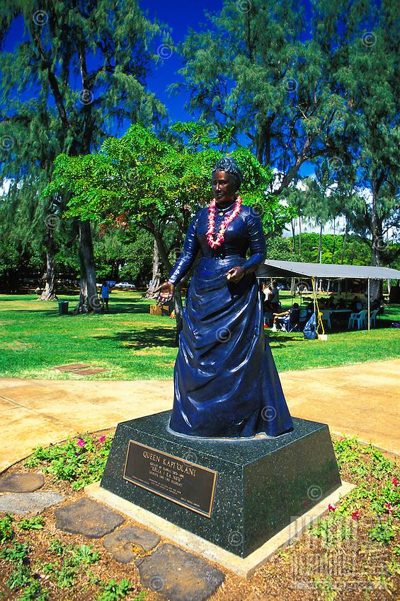 The statue of Queen Kapiolani stands at the entrance to Kapiolani Park near Waikiki.