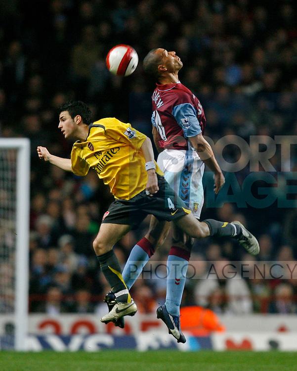 Villa's John Carew (R) and Arsenal's Cesc Fabregas.