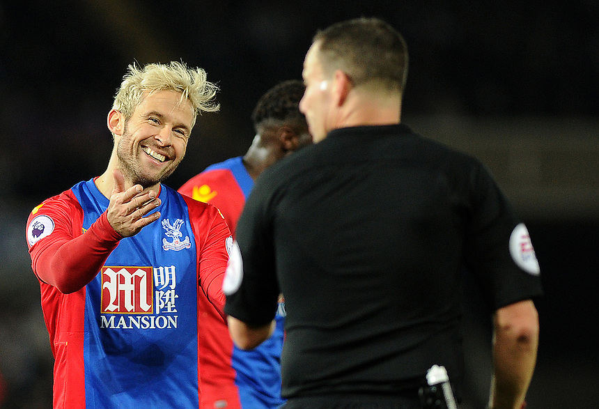 Crystal Palace's Yohan Cabaye laughs after receiving a yellow card from Referee Kevin Friend <br /> <br /> Photographer Ashley Crowden/CameraSport<br /> <br /> The Premier League - Swansea City v Crystal Palace - Saturday 26th November 2016 - Liberty Stadium - Swansea <br /> <br /> World Copyright &copy; 2016 CameraSport. All rights reserved. 43 Linden Ave. Countesthorpe. Leicester. England. LE8 5PG - Tel: +44 (0) 116 277 4147 - admin@camerasport.com - www.camerasport.com