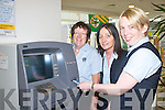 Helen Foley, Elaine O'Shea and Therese Buckley use the new ATM at Killarney Credit Union on Monday.