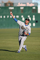 Mitchell White (33) of the Rancho Cucamonga Quakes throws in the outfield before pitching against the Lancaster JetHawks at The Hanger on April 28, 2017 in Lancaster, California. Lancaster defeated Rancho Cucamonga, 16-10. (Larry Goren/Four Seam Images)