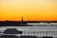 Nov. 12, 2010 - New York City, NY - The sun sets behind the Staue of Liberty in New York City November 12, 2010. (Photo by Alan Greth)