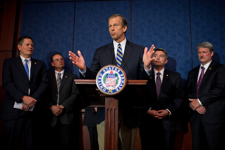 UNITED STATES - MAY 14: From left, Sen. Steve Daines, R-Mont., Jeff Slaven, president of the Virginia Cattlemen's Association, Sens., John Thune, R-S.D., Cory Gardner, R-Colo., and Paul Wegner, president of the California Farm Bureau, attend a news conference in the Capitol Visitor Center with agriculture leaders to urge passage of the trade promotion authority legislation, May 14, 2015. (Photo By Tom Williams/CQ Roll Call)