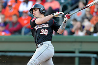Designated hitter Elliott Caldwell (30) of the South Carolina Gamecocks bats in the Reedy River Rivalry game against the Clemson Tigers on March 1, 2014, at Fluor Field at the West End in Greenville, South Carolina. South Carolina won, 10-2.  (Tom Priddy/Four Seam Images)