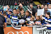 Young Bath supporters in the crowd wait to collect autographs. Bath Rugby Captain's Run on October 30, 2015 at the Recreation Ground in Bath, England. Photo by: Patrick Khachfe / Onside Images