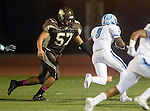 Torrance, CA 10/02/15 - Luis Aguiar (West #57) and Floyd Willis II (Carson #9) in action during the Carson-West Torrance CIF varsity football game at West Torrance High School.  Carson defeated West Torrance 34-27.