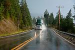 Truck driving on rainy wer road near Flathead Lake, Montana