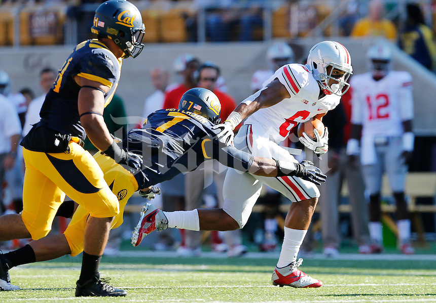 Ohio State Buckeyes wide receiver Evan Spencer (6) tries to break a tackle from California Golden Bears linebacker Jalen Jefferson (7) in the first quarter of the NCAA football game at Memorial Stadium in Berkeley, California,  Saturday afternoon, September 14, 2013. The Ohio State Buckeyes defeated the California Golden Bears 52 - 34. (The Columbus Dispatch / Eamon Queeney)