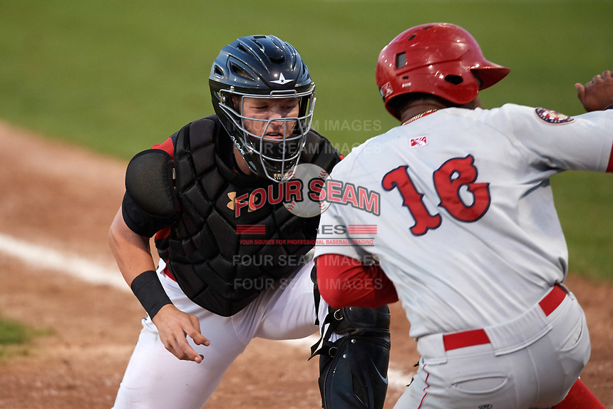 Batavia Muckdogs catcher Jared Barnes (26) tags Joshual Ramirez (16) attempting to score a run during a game against the Auburn Doubledays on August 26, 2017 at Dwyer Stadium in Batavia, New York.  Batavia defeated Auburn 5-4.  (Mike Janes/Four Seam Images)