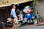 People walk past the Jidai-ya (era) Store in the trendy neighborhood of Kichijoji in Musashino City,  Tokyo, Japan on 16 Sept. 2012.  Photographer: Robert Gilhooly