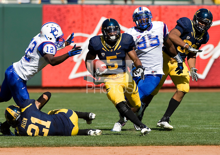 September 17, 2011:  California's Brendan Bigelow rushes through the line of scrimmage for a big gain during a game against Presbyterian Football at AT&T Park, San Francisco, Ca    California Defeated Presbyterian 63 - 12