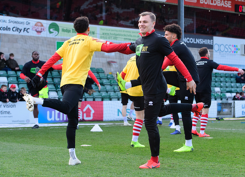 Lincoln City's Bruno Andrade, left, and Lincoln City's Harry Anderson during the pre-match warm-up<br /> <br /> Photographer Chris Vaughan/CameraSport<br /> <br /> The EFL Sky Bet League Two - Lincoln City v Northampton Town - Saturday 9th February 2019 - Sincil Bank - Lincoln<br /> <br /> World Copyright © 2019 CameraSport. All rights reserved. 43 Linden Ave. Countesthorpe. Leicester. England. LE8 5PG - Tel: +44 (0) 116 277 4147 - admin@camerasport.com - www.camerasport.com