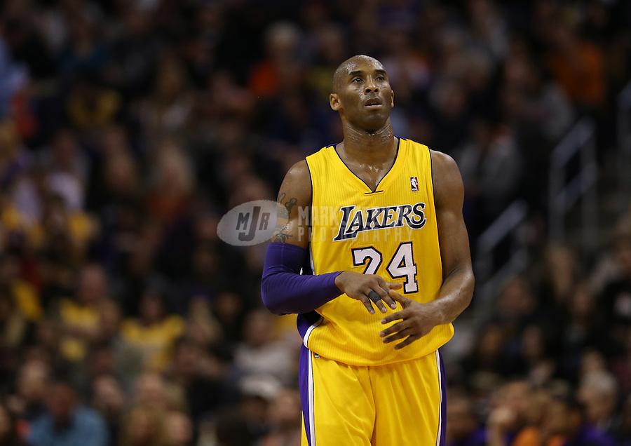 Jan. 30, 2013; Phoenix, AZ, USA: Los Angeles Lakers guard Kobe Bryant (24) against the Phoenix Suns at the US Airways Center. Mandatory Credit: Mark J. Rebilas-
