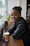 BRAAMFONTEIN, SOUTH AFRICA - MARCH 22: Student Nontokozo Dladla drinks a coffee at the popular Juta street on March 22, 2016 in Braamfontein in downtown Johannesburg, South Africa. The area, a culture hub with many students, artists etc., has many trendy brand stores and a popular Saturday rooftop market. (Photo by Per-Anders Pettersson/Getty Images)