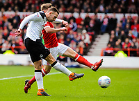 Derby County's forward Andi Weimann (19) beats Nottingham Forest's forward Ben Osborn (11) to shoot wide during the Sky Bet Championship match between Nottingham Forest and Derby County at the City Ground, Nottingham, England on 10 March 2018. Photo by Stephen Buckley / PRiME Media Images.