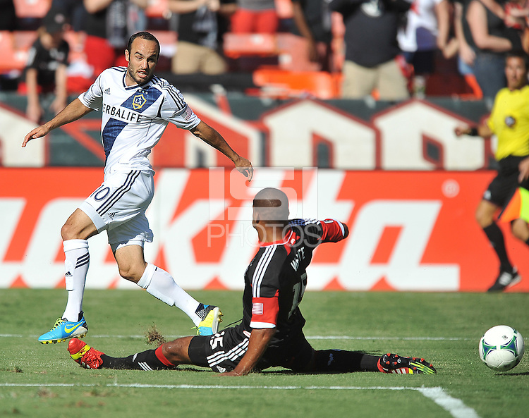 Landon Donovan (10) of the Los Angeles Galaxy goes against Ethan White (15) of D.C. United.  D.C. United tied the Los Angeles Galaxy 2-2, at RFK Stadium, Saturday September 14 , 2013.