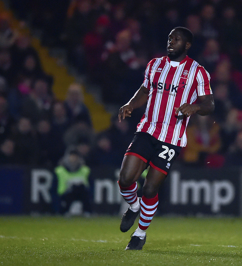 Lincoln City's John Akinde<br /> <br /> Photographer Andrew Vaughan/CameraSport<br /> <br /> The EFL Sky Bet League Two - Lincoln City v Exeter City - Tuesday 26th February 2019 - Sincil Bank - Lincoln<br /> <br /> World Copyright © 2019 CameraSport. All rights reserved. 43 Linden Ave. Countesthorpe. Leicester. England. LE8 5PG - Tel: +44 (0) 116 277 4147 - admin@camerasport.com - www.camerasport.com