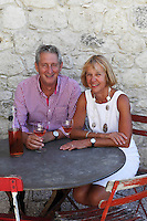 Anne Buerk and her partner Juilan enjoying a Rosé on their patio