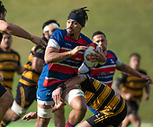 Savelio Ropati looks for support as the Bombay defenders arrive to stop his run. Counties Manukau Premier 1 McNamara Cup Final between Ardmore Marist and Bombay, played at Navigation Homes Stadium on Saturday July 20th 2019.<br />  Bombay won the McNamara Cup for the 5th time in 6 years, 33 - 18 after leading 14 - 10 at halftime.<br /> Photo by Richard Spranger.