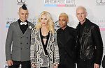 LOS ANGELES, CA - NOVEMBER 18: Adrian Young, Gwen Stefani, Tony Kanal and Tom Dumant of No Doubt attend the 40th Anniversary American Music Awards held at Nokia Theatre L.A. Live on November 18, 2012 in Los Angeles, California.
