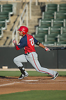 Austin Davidson (23) of the Hagerstown Suns follows through on his swing against the Kannapolis Intimidators at CMC-Northeast Stadium on June 16, 2015 in Kannapolis, North Carolina.  The Suns defeated the Intimidators 8-4.  (Brian Westerholt/Four Seam Images)