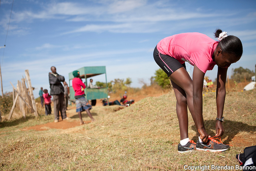 Florence Kiplagat prepares for a morning training session in Kaplelach, Kenya near Eldoret.