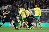 George Saville of Millwall challenges James Maddison of Norwich City for the ball during Norwich City vs Millwall, Sky Bet EFL Championship Football at Carrow Road on 1st January 2018