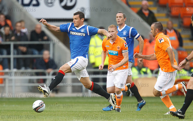 Lee McCulloch strides forwards with the ball