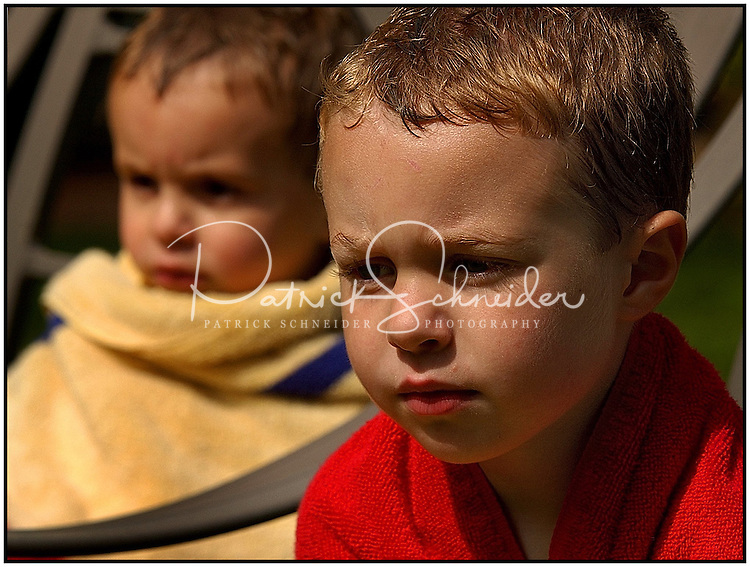 Model-released photo available to show emotions on the faces of two young boys. Could represent worry, thinking, concern, waiting, etc.