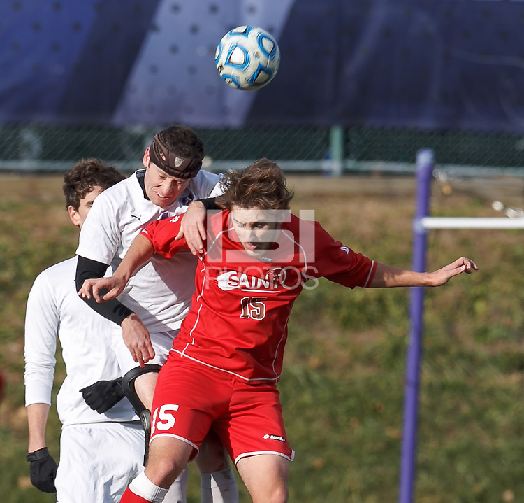 Amherst defender Ben Norton (4) and St. Lawrence forward Morgan Smith (15) battle for head ball.  NCAA Division III Sectionals. In double-overtime, Amherst College (white) defeated St. Lawrence University (red), 2-1, on Hitchcock Field at Amherst College on November 23, 2013.