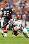9 October 2005: Terrence McGee (24), corner back for the Buffalo Bills, bobbles while being tacked by Travis Minor (28) - but recovers to complete a 54-yard kickoff return against the Miami Dolphins on October 9, 2005 at Ralph Wilson Stadium, in Orchard Park, NY. The Bills defeated the division rival Dolphins 20-14. ..Mandatory Photo Credit: Ed Wolfstein