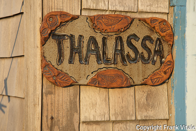 Hand-carved Sign on Thalassa's Front