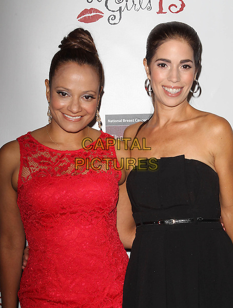 Judy Reyes, Ana Ortiz<br /> The National Breast Cancer Coalition Fund Presents The 13th Annual Les Girls  Held at Avalon, Hollywood, California, USA.<br /> October 7th, 2013<br /> half length red dress lace dress sleeveless black strapless <br /> CAP/ADM/KB<br /> &copy;Kevan Brooks/AdMedia/Capital Pictures