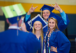 WINSTED, CT-062317JS04-Gilbert graduate Steven Marshall, jumps into a photo being taken of fellow graduates Grace Valickis, left, and Ali Brochu, right, prior graduation ceremonies Friday at the Gilbert School in Winsted. <br /> Jim Shannon Republican-American
