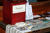 Campaign stickers lay next to a prayer box during a Green Party presidential nominee Jill Stein campaign rally at Old South Church in Boston, Massachusetts, on Sun., Oct. 30, 2016.